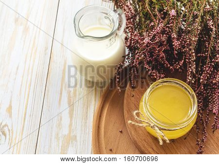 Milk, Heather Flowers And Honey. Wooden Table.
