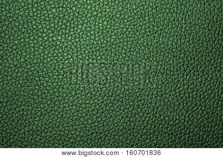Green leather texture leather background for design with copy space for text or image. Pattern of leather that occurs natural.