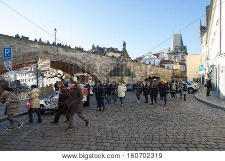 Peoples Under Charles Bridge In Prague.