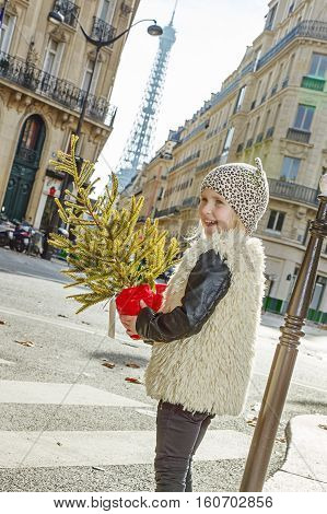 Smiling Girl With Christmas Tree In Paris, France Crossing Road
