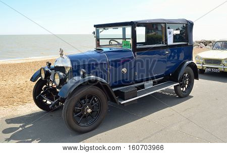 FELIXSTOWE, SUFFOLK, ENGLAND - MAY 01, 2016: Classic Blue Morris Oxford motor car on seafront promenade.
