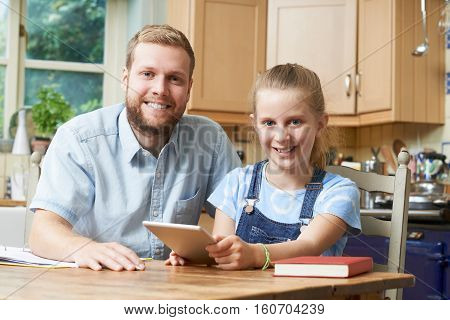 Male Home Tutor Helping Girl With Studies