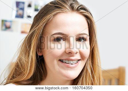 Portrait Of Smiling Teenage Girl Wearing Dental Braces