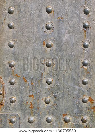 old metal surface with rivets, texture background