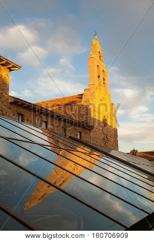 View of the San Francesco Church reflected on the glass cover of the museum in Astorga Spain