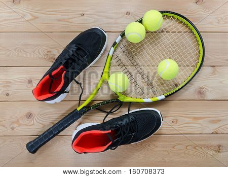 sport equipment. Tennis rackets and balls on wooden table
