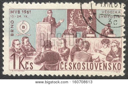 MOSCOW RUSSIA - CIRCA NOVEMBER 2016: a post stamp printed in CZECHOSLOVAKIA shows a scientific discussion group the series