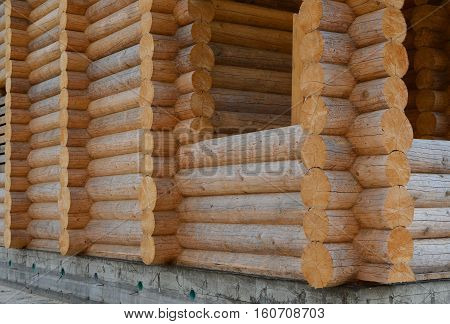 The structure of the log house. Construction of wooden  houses