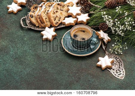 Traditional Christmas cake Stollen cookies coffee and decoration. Holidays food background