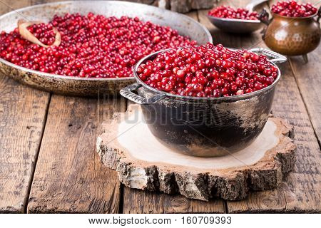 Wild cowberry (foxberry lingonberry) Red berries on vintage wooden table