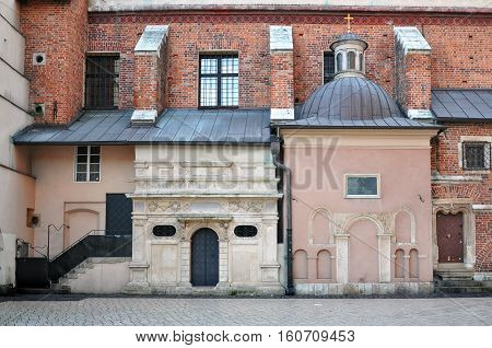 Detail of the facade of St Mary's church in Krakow Poland with attached ancient chapel.