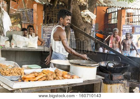 Illustrative image. Pondicgery Tamil Nadu India - Marsh 10. 2014. Shop of food restaurant in the street itinerant trade small merchant