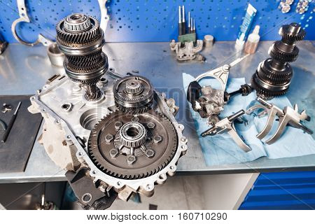 Cross-section of a car gearbox. mechanics work in the garage.