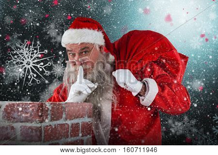Santa Claus with finger on lips standing beside chimney against snowflake pattern