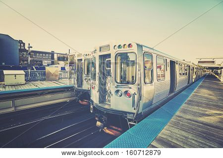 Retro Stylized Photo Of A Train On Platform In Chicago, Usa