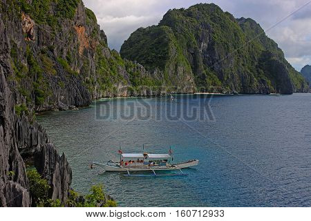 Boat on blue water. Traditional filippino boat in the sea. Palawan Philippines
