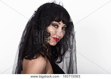 black widow in a veil, mysterious sad woman wearing lace.