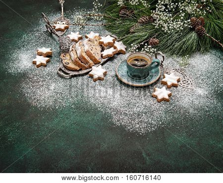 Christmas sweet food star cookies cake Stollen coffee and decoration. Holidays background vintage style toned