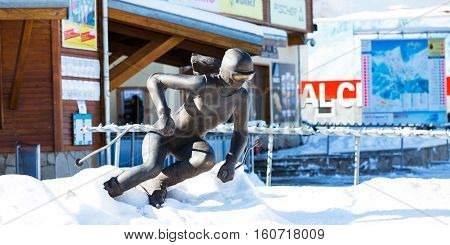 Bansko, Bulgaria - November 30, 2016: Winter ski resort Bansko cable car station and skier statue at the entrance