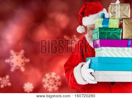 Santa claus holding sack of christmas gifts against digitally generated christmas background