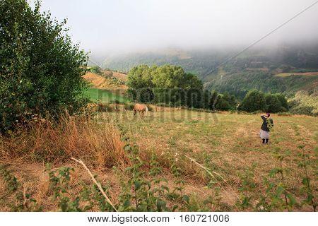 CEBREIRO SPAIN - AUGUST 09: Breeder with her horse on August 09 2016