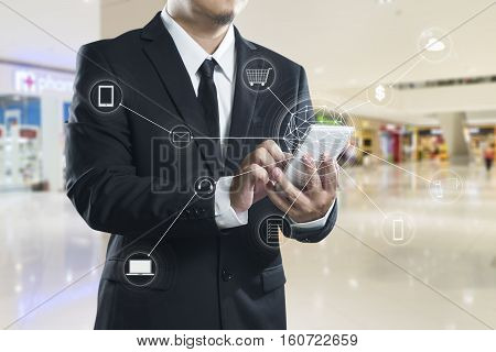 Man using mobile payments online shopping and icon customer network connection on screen m-banking and omni channel