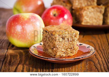 A piece of walnut cake with apples