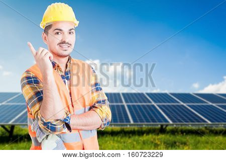 Attractive Engineer Pointing Up An Idea