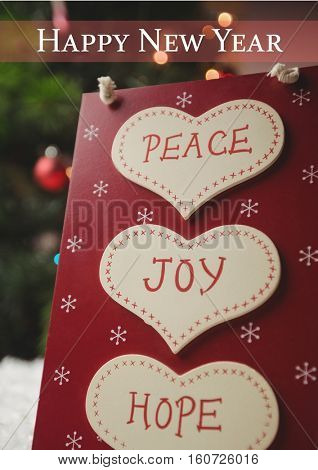 Close-up of happy new year wishes with message of peace, joy and hope on heart