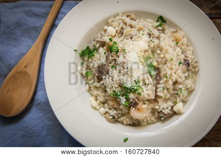 Italian risotto with mushrooms and fresh prawns