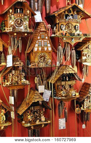 Heidelberg, Germany - April 20, 2014: Vintage wooden wall clocks in the form of a small house in a souvenir shop in Heidelberg.