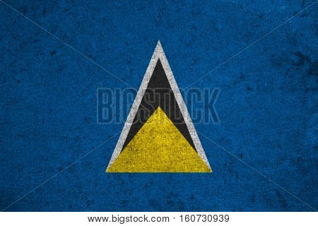 Saint Lucia Flag On An Old Grunge Background