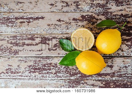 Fresh Ripe Lemons On Wooden Table. Top View With Copy Space