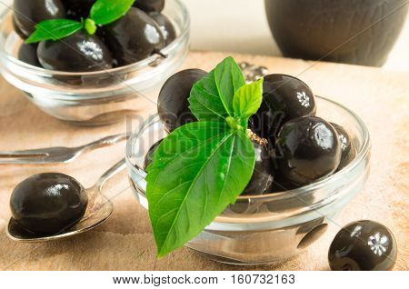 Brown Pickled Olives In A Transparent Cups