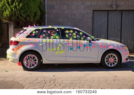 White car is covered in post it notes