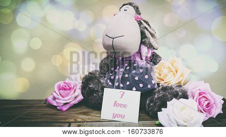 Plush Lamb And Pink Roses And A Wooden Background, A Note On The Paper