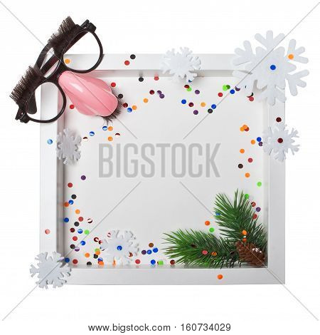 Composition in wooden frame with carnival mask and confetti