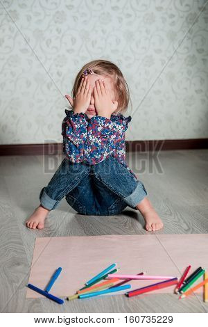 Child Sitting On The Floor  Near Crayons And Paper. Little Girl Drawing, Painting. Creativity Concep