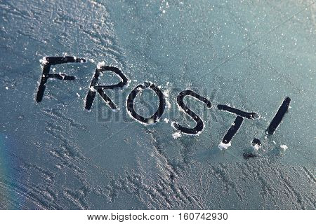 Frozen car window with a frost message text sign