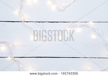 Christmas garland on wooden floor
