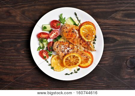 Baked chicken breast with orange sauce top view