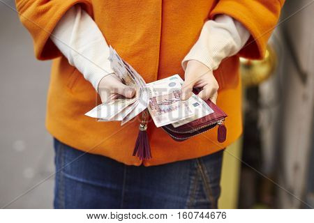Woman Hands Holding Purse With Russian Roubles