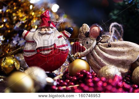 toy of Santa Claus and Christmas angel. Santa Claus christmas decoration.Christmas greeting card.Christmas symbol