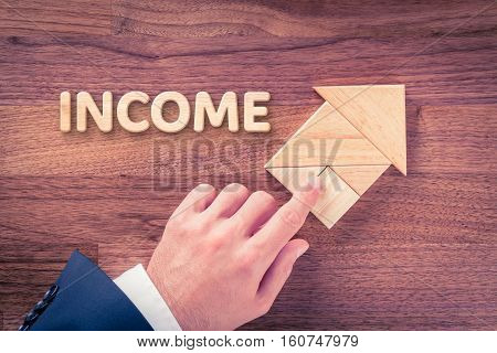 Increase income concept. Businessman plan income growth represented by arrow.