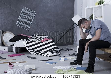 Sad Man Surrounded By Mess