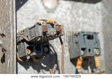Old Rusted Electrical Panel with Fuses and Contacts .