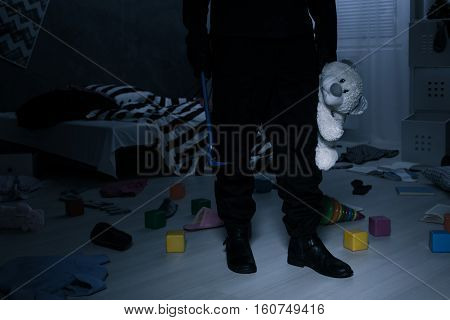 Burglar Holding A Teddy Bear