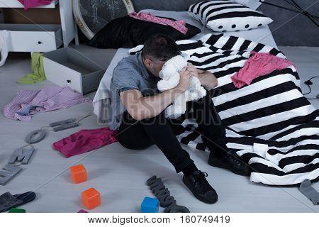 Sad Man In Children's Room