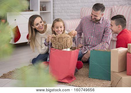 Parents And Children Unpacking Presents