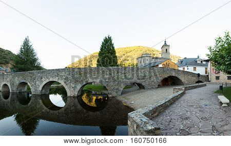 Viewe of the Roman bridge and Church of San Nicola da Bari in Molinaseca Spain